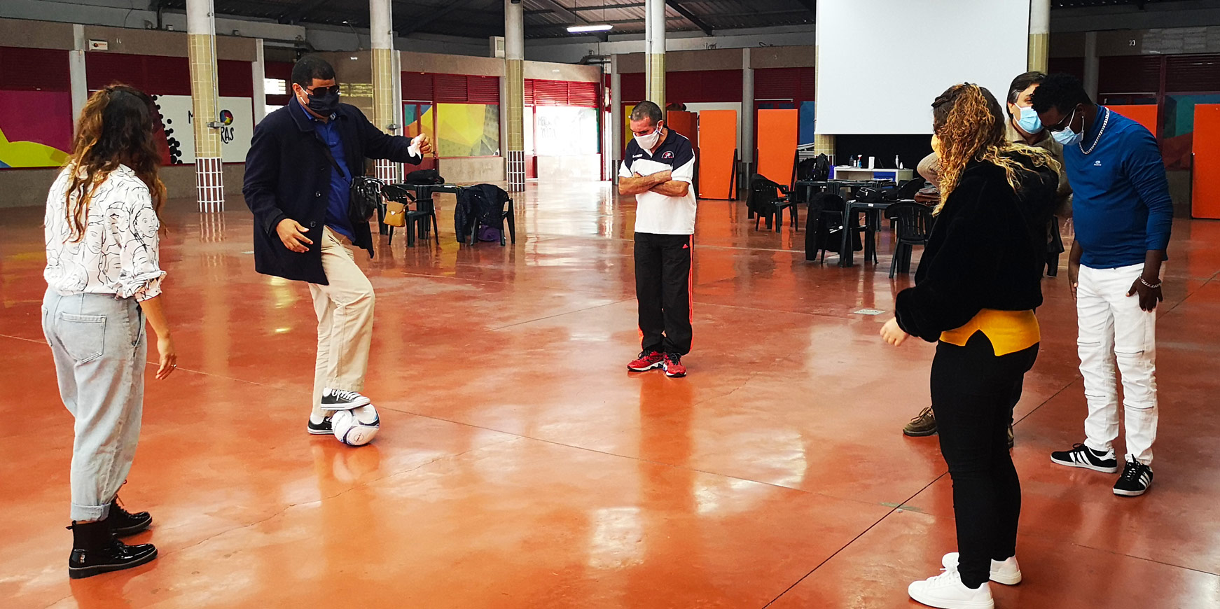 Blind participants during a workshop delivered by Integrated Dreams with participants experiencing playing blind football for the first time