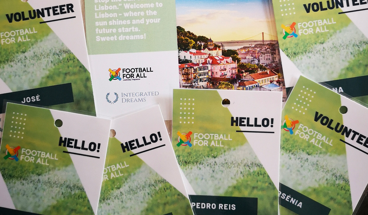 Football For All Leadership Programme 2019 badges with participant names, logos and a picture of Lisbon in the background