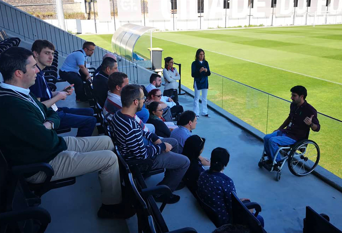 Football For All Leadership Programme class of 2019 visiting the Portuguese Football Association in the stands with guide 2018 Alumni Eduardo Maia