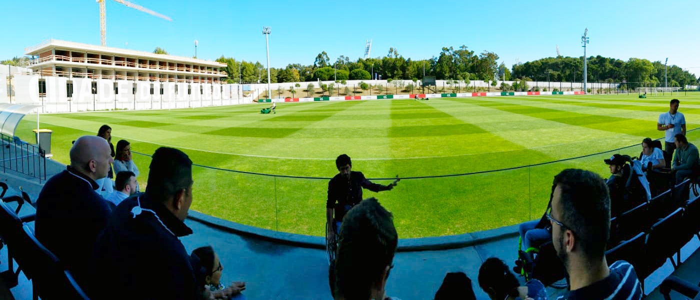 FFALP class of 2019 visiting the Portuguese FA with 2018 Alumni Eduardo Maia as guide and football pitch in the background