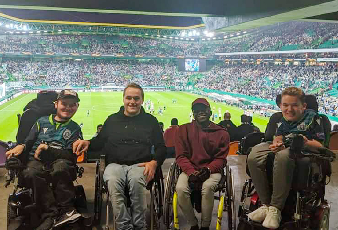 Football For All Leadership Programme wheelchair participants at Sporting Lisbon stadium attending football match with stands in the background